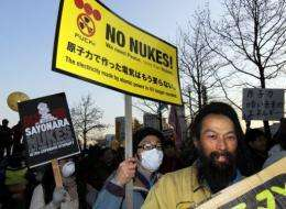 "The anti-nuclear activists urged Tokyo to ""give back our hometown. Protect our children"""