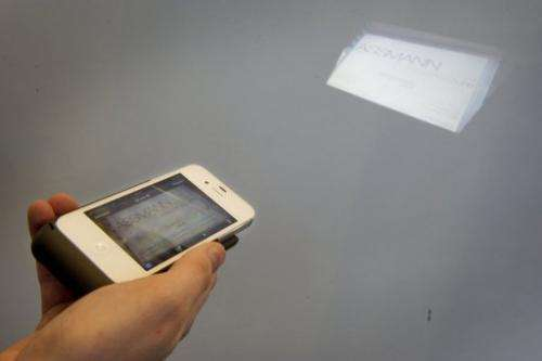 The company Assmann shows an Iphone jacket with a built in projector at the world's biggest high-tech fair,  CeBIT
