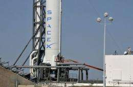 The Dragon space capsule atop the Falcon 9 rocket will be launched early Tuesday