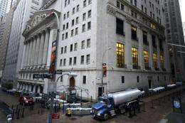 The New York Stock Exchange is seen as New Yorkers clean up the morning after Sandy made landfall