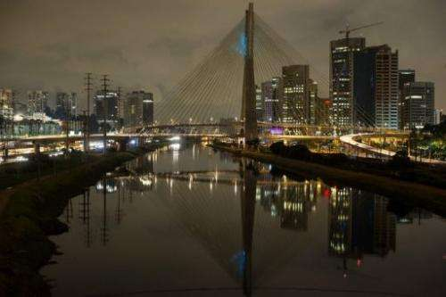 The Octavio Frias de Oliveira bridge over the Pinheiros river in Sao Paulo, has its lights partially off