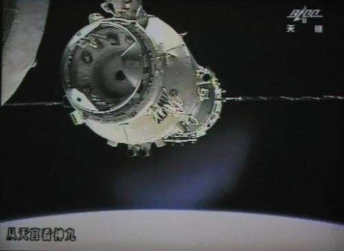 The spacecraft approaches the module for docking