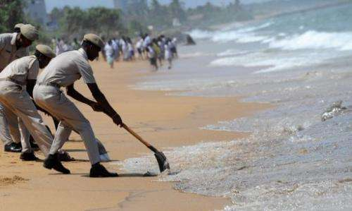 Thin layers of furnace oil washed ashore in several places on Saturday in and around Colombo