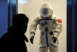 "Three astronauts will blast off on board Shenzhou (""Divine Vessel"") IX between June and August"