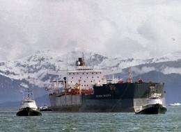 Tugboats tow the Exxon Valdez off Bligh Reef in Prince William Sound on April 5, 1989, two weeks after it ran aground