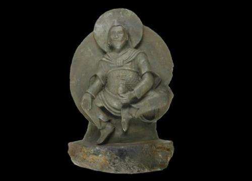 Undated handout picture shows a thousand year-old ancient Buddhist statue known as the Iron Man