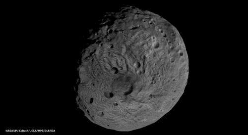 Vesta likely cold and dark enough for ice