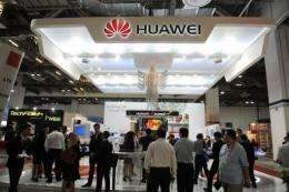 Visitors gather at the Huawei both during the CommunicAsia telecom expo