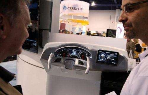 Visitors look at the Audi MMI 3G technology system, powered by Invidia, at CES in Las Vegas