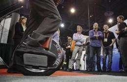 Weird gadgets at CES: Motorized unicycle, anyone? (AP)