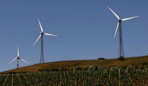 Wind turbines spin in a village between Palermo and Trapani in Italy
