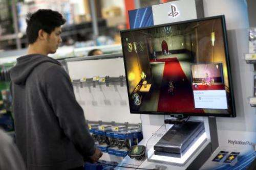 A customer is seen playing a game on Sony Playstation 4, on display at Best Buy store in Pembroke Pines, Florida, on November 15