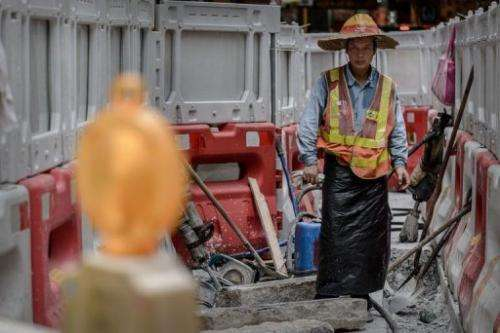 A labourer works at a roadworks site in Hong Kong on July 9, 2013