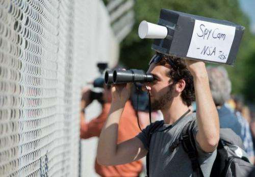 A man protests outside a US National Security Agency listening station in Darmstadt,Germany, on July 20, 2013
