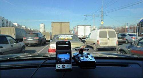 A mini camera sits on a dashboard of a car in Moscow, March 12, 2013