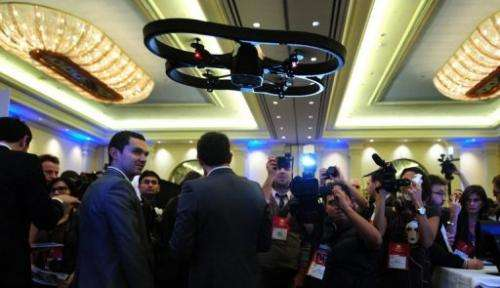 An A.R. Drone helicopter by Parrot flies overhead during an electronics show on January 6, 2010 in Las Vegas, Nevada