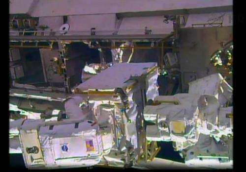 A NASA TV still image shows the International Space Station during an spacewalk by NASA astronauts Rick Mastracchio and Mike Hop
