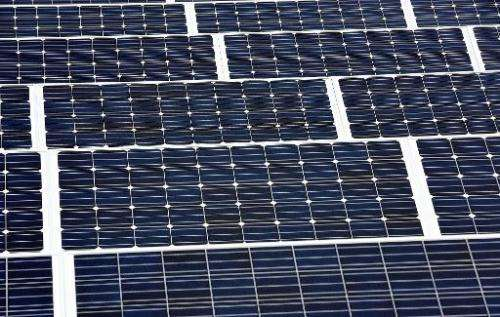 A picture shows solar panels installed on the roof of a building in Lille on September 9, 2013
