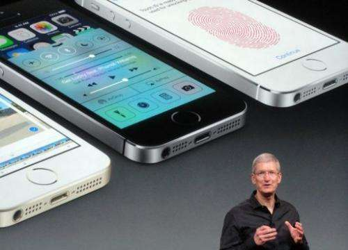 Apple chief executive Tim Cook introduces the new iPhone 5S on September 10, 2013 in Cupertino, California
