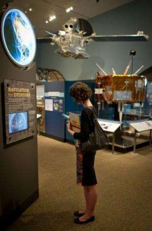 """A visitor explores the """"Time and Navigation"""" exhibition at the Smithsonian National Air and Space Museum, April 10, 20"""