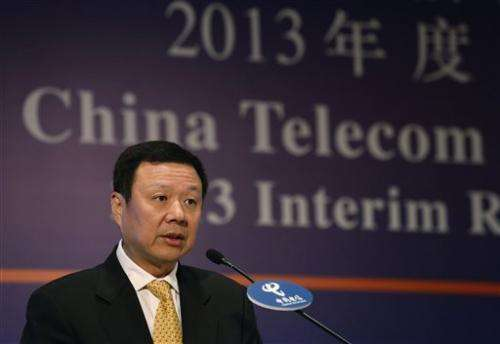 China Telecom profit rises after it offers iPhone