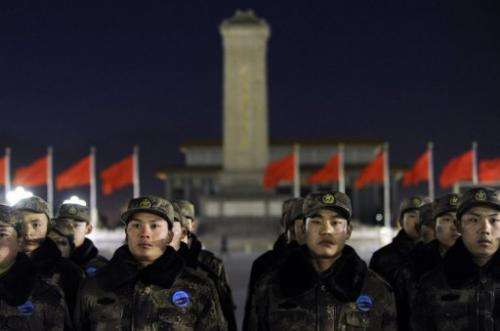Chinese soldiers prepare to watch a flag-raising ceremony at Beijing's Tiananmen Square on January 1, 2013