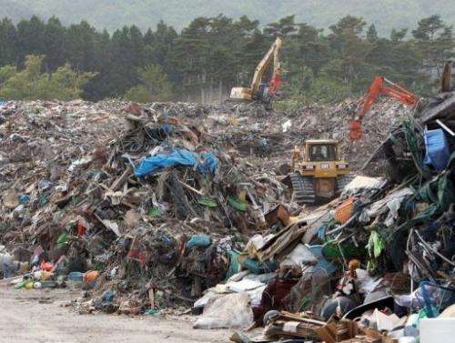 Earthquake and tsunami debris lie at Yamada town in Iwate prefecture on June 6, 2011