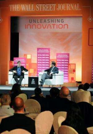 Facebook co-founder Eduardo Saverin (on stage, L) speaks during an interview in Singapore, on February 21, 2013