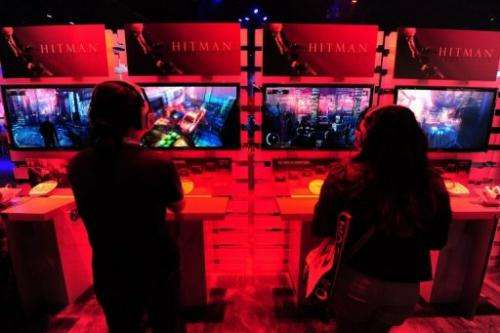 Gaming fans play Playstation 3's Hitman Absolution in Los Angeles, June7, 2012
