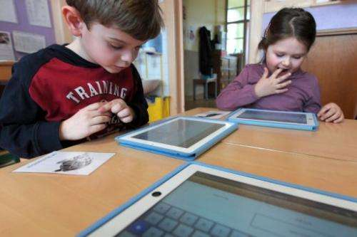 Nursery school pupils work with tablet computers on March 18, 2013 in Haguenau, northeastern France