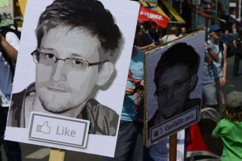 People take part in a protest against the US National Security Agency (NSA) in Berlin on July 27, 2013