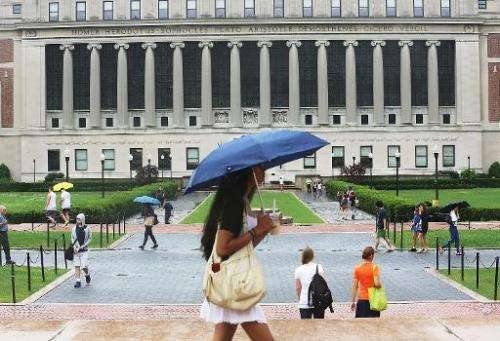 People walk on the Columbia University campus on July 1, 2013 in New York City