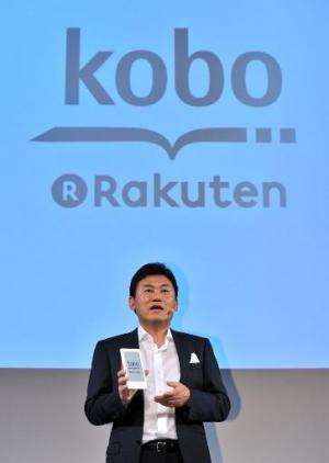 """Rakuten chairman and CEO Hiroshi Mikitani launches the company's electronic book player """"Kobo Touch"""", in Tokyo on July"""
