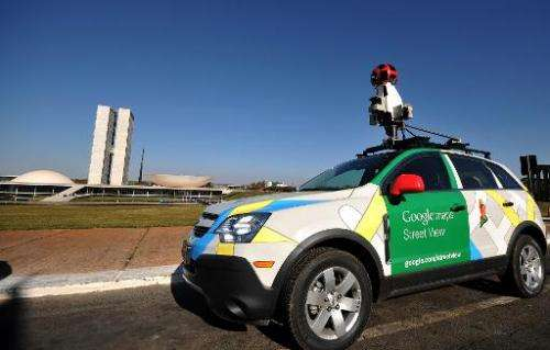 The Google street view mapping and camera vehicle stands in front of the National Congress as it charts the streets of Brasília,