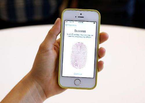 The new iPhone 5S with fingerprint technology is displayed during an Apple product announcement at the Apple campus on September