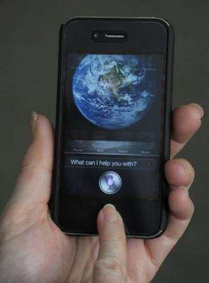 "The ""Siri"" digital personal assistant is displayed on an Apple iPhone 4S in Washington, DC on March 13, 2012"