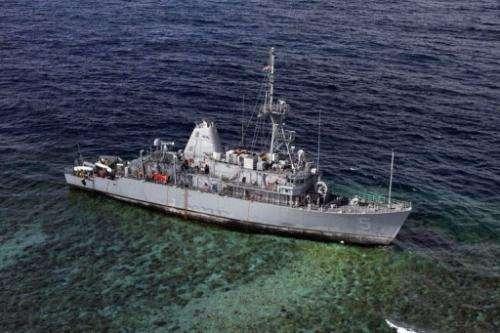 The USS Guardian sits aground on January 22, 2013 on the Tubbataha Reef