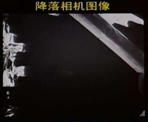 This screen grab taken from CCTV live broadcasting footage shows an image of China's first lunar rover transmitted back to the c