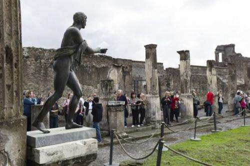 Tourists visit the Roman site of Pompei on October 27, 2011