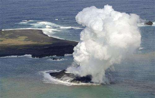 Volcano raises new island far south of Japan