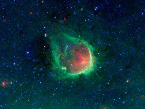 What glows green in space?