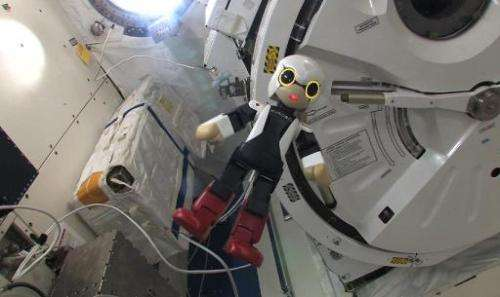 "This handout picture received from the Kibo Robot Project on November 6, 2013 shows the humanoid robot ""Kirobo"" inside"