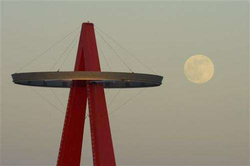 AP PHOTOS: Largest and brightest full moon of year