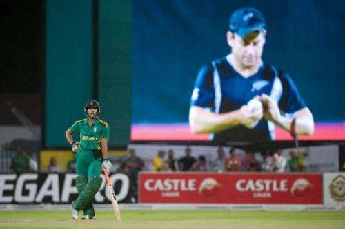This file photo shows South Africa's Farhaan Berhardien (L) waiting while New Zealand's skipper Brendon McCullum is seen on the