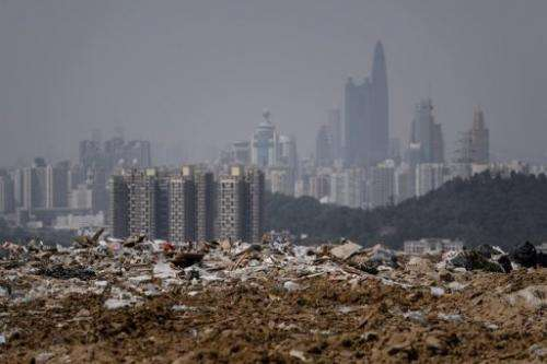 A landfill in Hong Kong on March 6, 2013, as the Chinese city of Shenzhen looms in the background