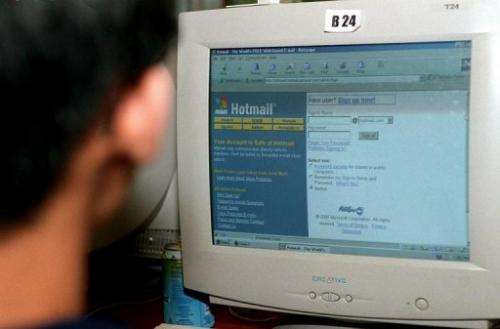 A man checks his Hotmail e-mail account at a cyber cafe in Singapore on September 21, 2000