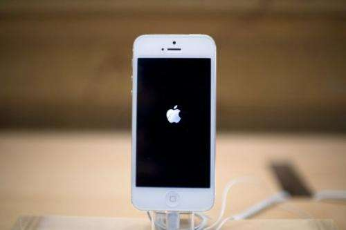 Apple's iPhone 5 smartphone on display in an Apple store, on September 21, 2012 in Paris