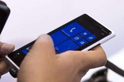 A man navigates with Windows 8 on a Nokia Phone on November 14, 2012, in Paris