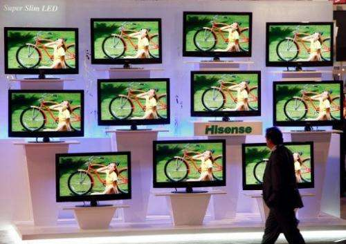 A man walks past LED televisions at the 2009 International Consumer Electronics Show in Las Vegas on  January 10, 2009