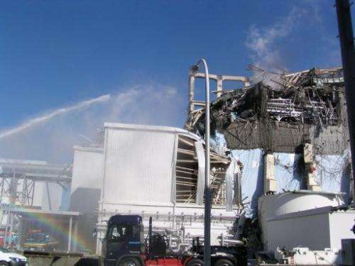 A newly-released picture of water being sprayed on the unit 3 reactor building at Fukushima taken on March 15, 2011